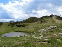 Lago alpino in prossimità della sella tra la Colma dei Lavaggi ed il monte Camparient